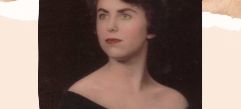 Sepia toned photo of a beautiful woman of 18yrs old (1950s) with dark brown hair (Elizabeth Taylor styled), red lips, dark brown wrap just off the shoulders, looking off into the distance.