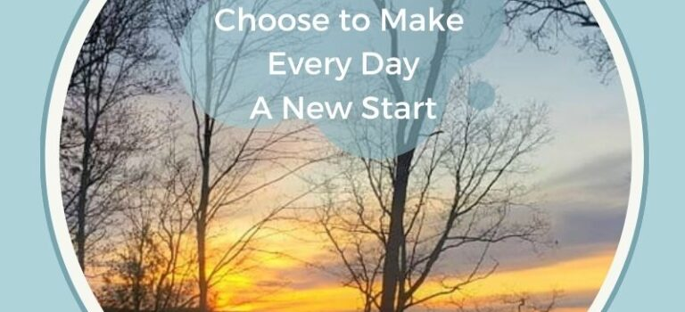 Sun rise on a calm lake with blues, orange, yellow, and pink. Bare trees in the forefront. White text with title Choose to Make Every Day A New Start