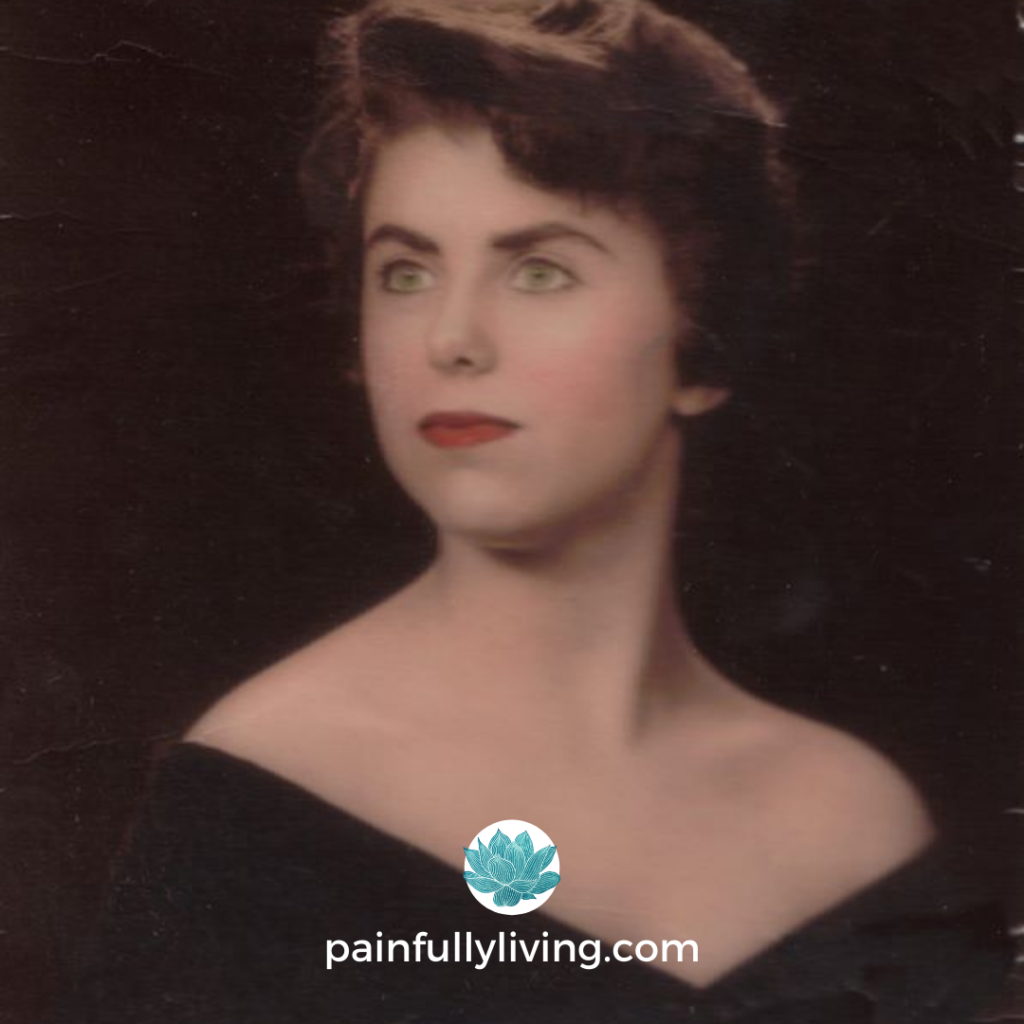 A portrait of 18 year old woman, looking a bit like Elizabeth Taylor wearing an off shoulder shawl. She is staring off to the side, with a serious expression.