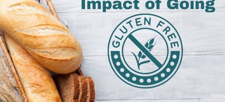 Whitewashed boards with an image of bread, sprigs of wheat and a green and white checkered cloth. The title text in dark teal with a graphic gluten free, in a circle.