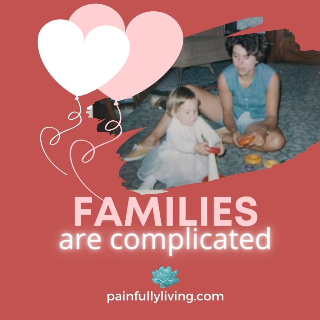 Red background with a pink and white heart in top right corner; a ragged edged photo of a young woman sitting on the floor watching her one year old daughter play.