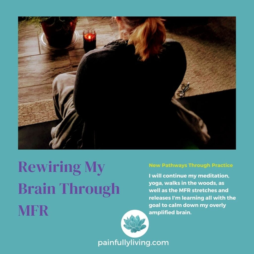 An image of me in my basement meditation, yoga space.  I'm seated, crosslegged, meditating.  Purple font: Rewiring My Brain Through MFR. Gold font: New Pathways Through Practice